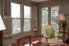 Tall windows are placed at low heights so people of all heights can see the view outside.