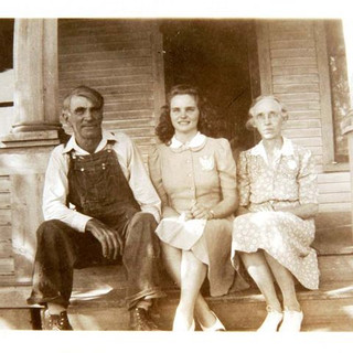 mother with her mother and father at far