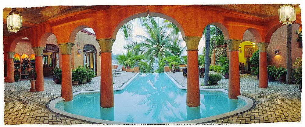 casa arabia pool with palms
