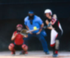 Softball player hitting the ball