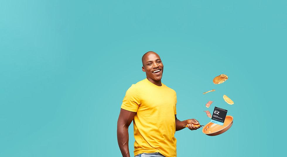 Man laughing flipping pancakes