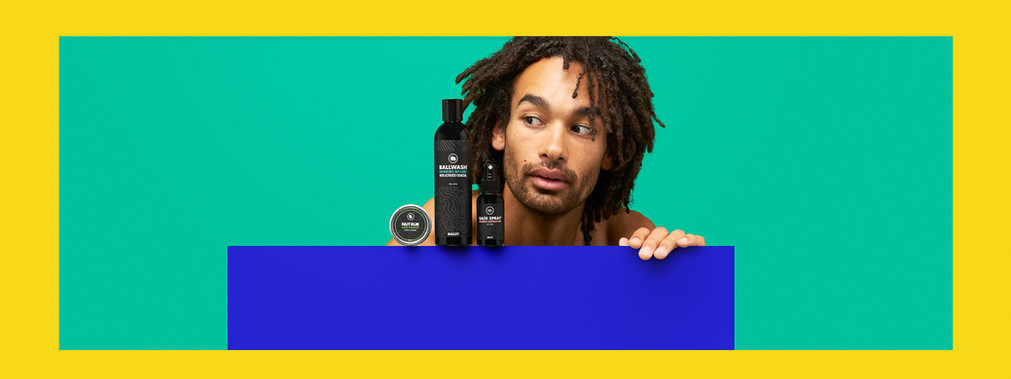 male checking men skincare products