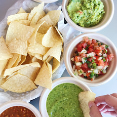Chips and dip: salsa, queso, and guac with chips