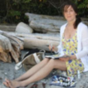 Local Salt Spring Island artist Daina Deblette painting in her watercolour journal on Beddis Beach