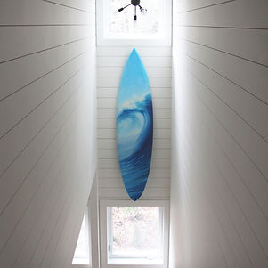 Local Salt Spring Island artist Daina Deblette's custom commissioned painted surfboad hanging in client's home