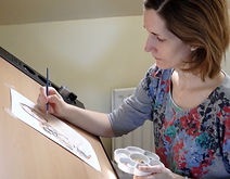 Mandy painting a portrait of an NHS keyworker and her dog