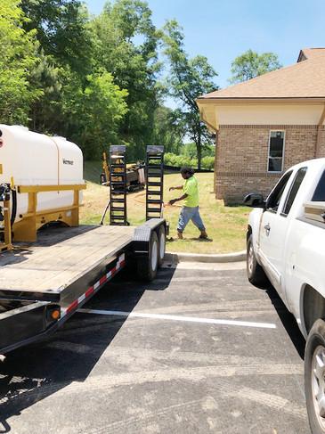 Shiflett Enterprises truck and equipment pictured on jobsite.