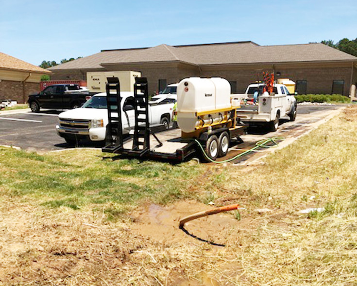 Shiflett Enterprises on jobsite with truck and other outdoor service equipment