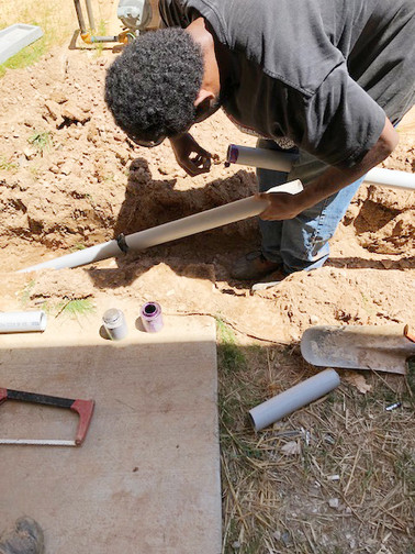 man prepares pipe for underground cabling during a Shiflett Enterprises construction job