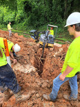 Men watching large machinary drill in Georgia by Shiflett Enterprises, Inc.