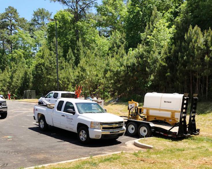 Shiflett Enterprises, Inc. truck on jobsite with other equipment.