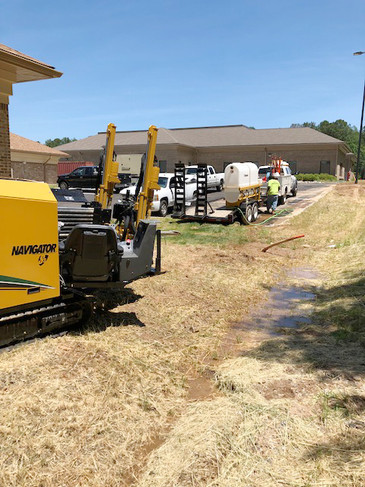 Shiflett Enterprises equipment pictured next to the covered ditch from underground construction