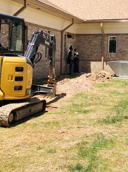 Shiflett Enterprises Inc GA with mini excavator on jobsite