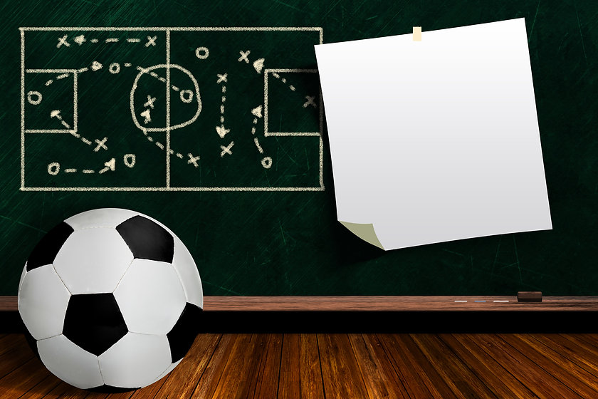 Soccer ball and play strategy drawn on a background chalk board with copy space.jpg