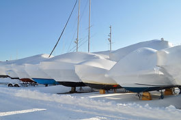 Shrinkwrap row of boats in the snow.jpg