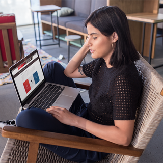 girl-working-with-a-macbook-pro-mockup-s