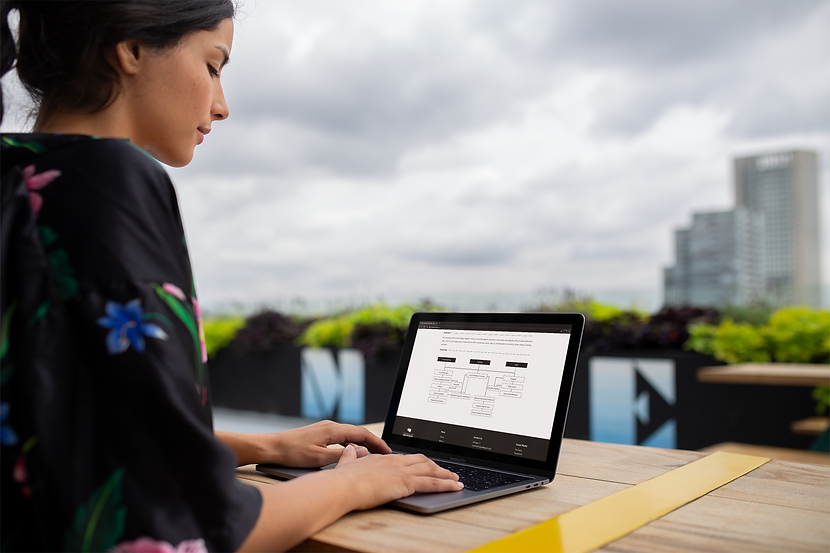 woman-working-with-macbook-pro-mockup-on