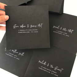 White ink text black envelope