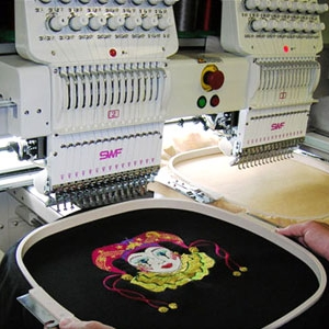 Large clown embroidery on a blanket