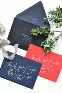 Navy, black, red envelopes white ink