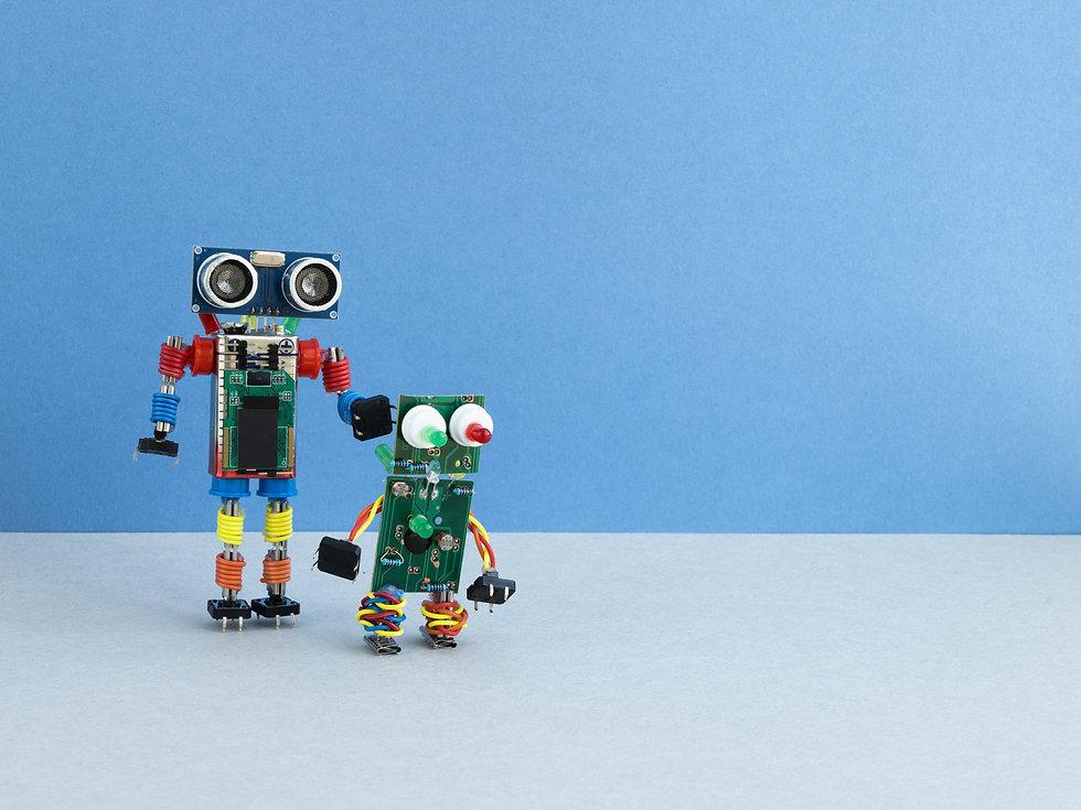 Back to school concept. A metal robot an