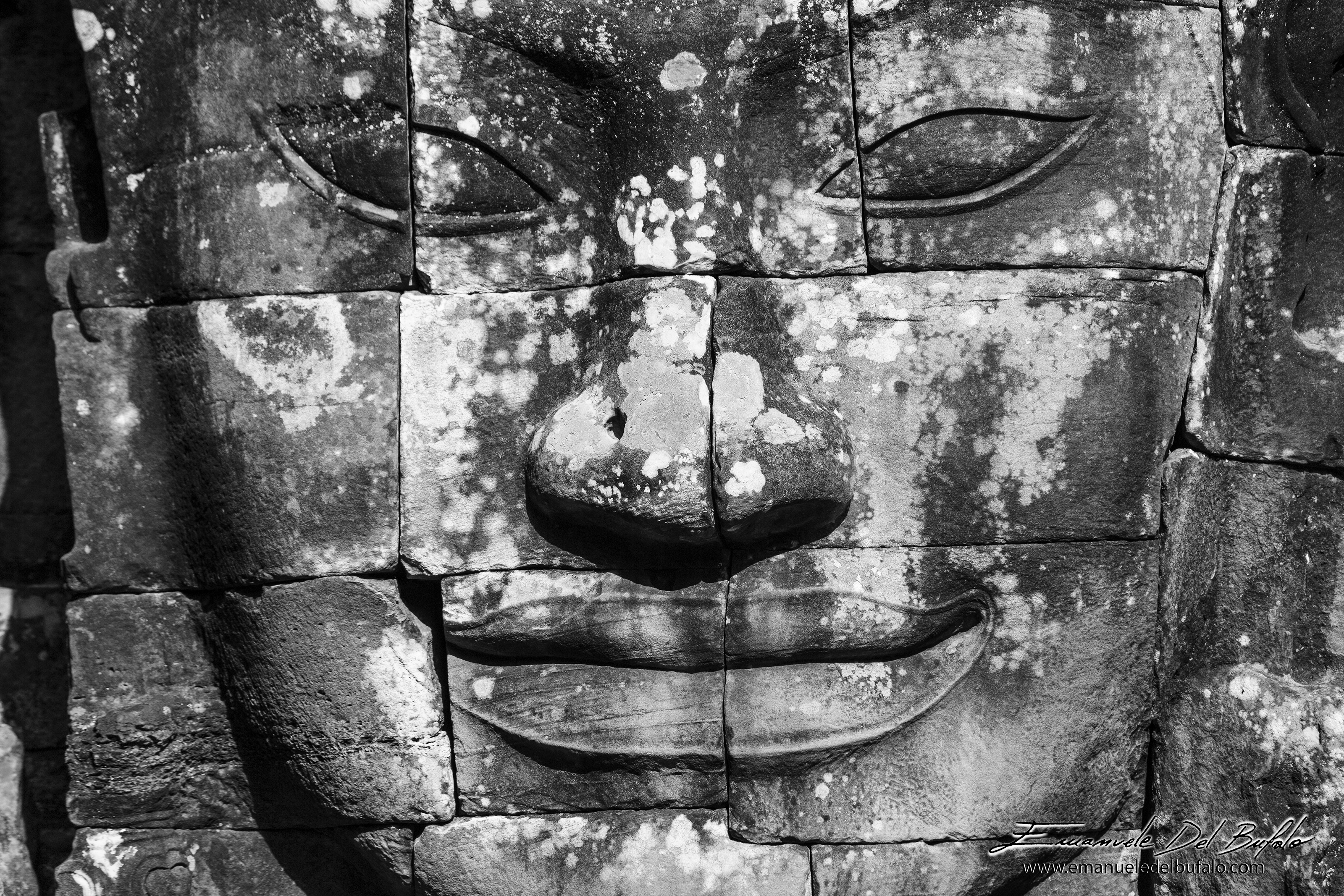 www.emanueledelbufalo.com #asia #cambodia #bayon #buddha_face #smiling #travel #B&W