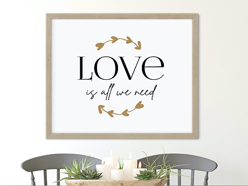 love is all we need sign printed and framed on wall over farmhouse table