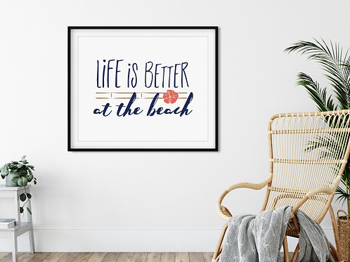 life is better at the beach sign printed and framed next to wicker chair
