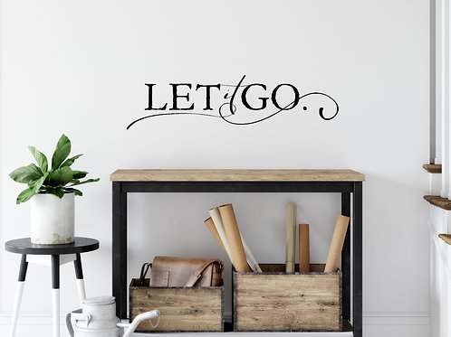 let it go art project idea vinyl on wall over table with plant