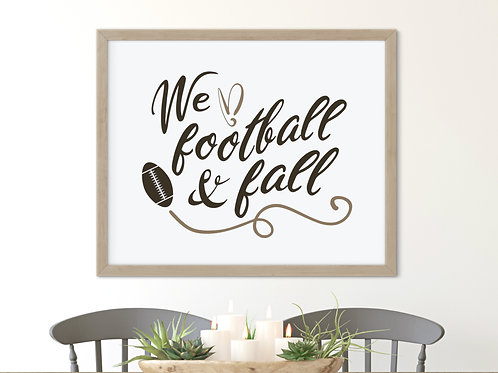 neutral color we love football and fall sign in wood frame over farmhouse table