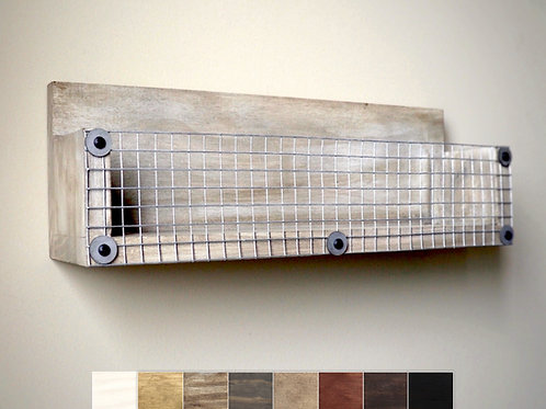 weathered wood box shelf mounted on wall with squares showing color choices
