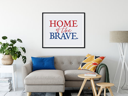home of the brave sign in red and blue over couch