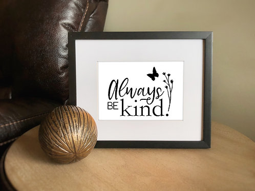 always be kind sign in frame on side table with decorative ball