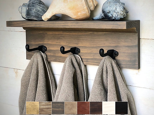 rustic gray shelf with hooks displaying shells and towels and examples of color choices