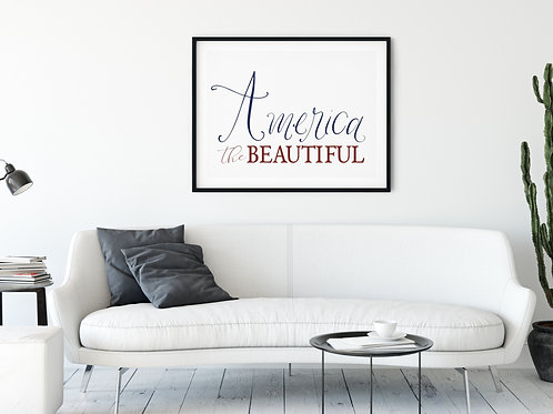 america the beautiful red and blue art framed over couch