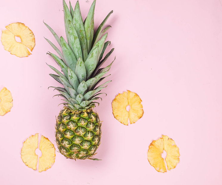 ripe-juicy-pineapple-on-pink-background-and-dried-pineapple-wedges-around-fruit-chips-heal
