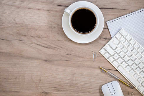 workspace-with-office-supplies-and-coffee-cup.jpg