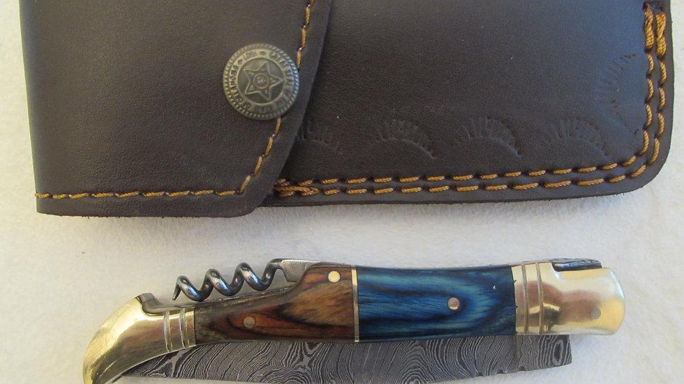 Damascus steel folding knife with corkscrew