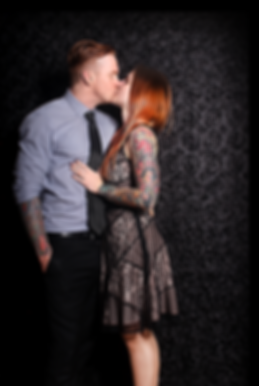 Couple Kissing in Photo Booth