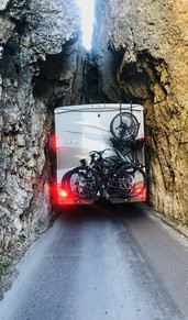 RV squeezing through roadway tunnel