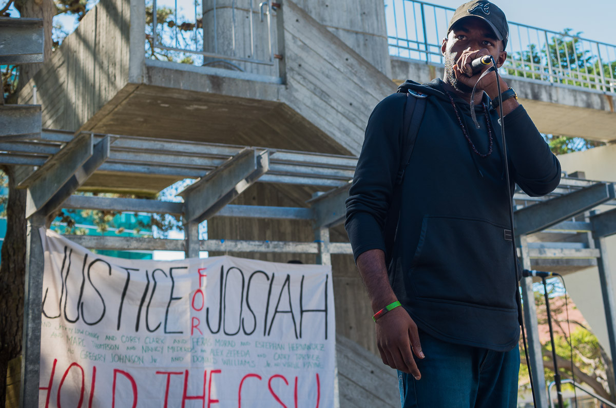 SF State Africana studies and BECA major, Damion Square, 28, speaks at the protest for the murder of Humboldt State student, David Josiah Lawson, on Monday, Oct. 15, 2018.