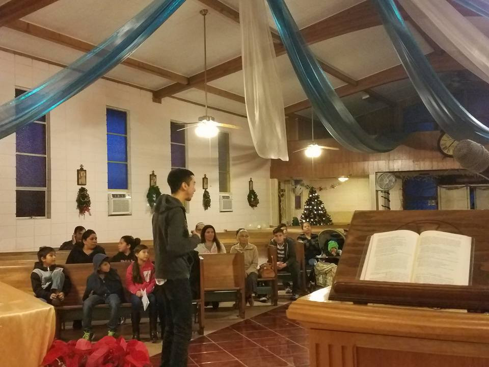 Claretian Seminarian Jose sharing the Good News with the poor