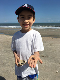 A youngster with a dolphin earbone