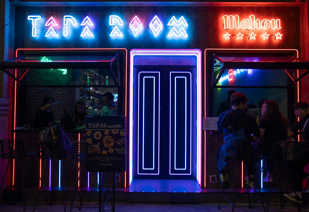 The catch bar with neon lights exterior decoration