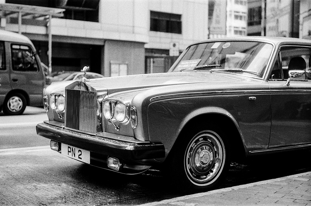 A classic Rolls-Royce parked on the street in Sheung Wan