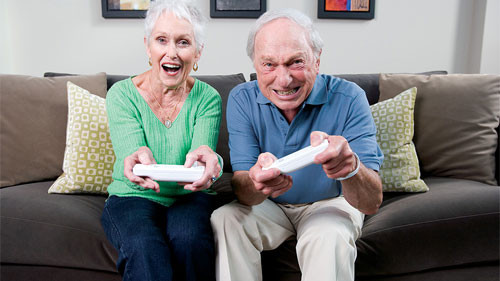 Elderly Couple Playing the Nintendo Wii Console
