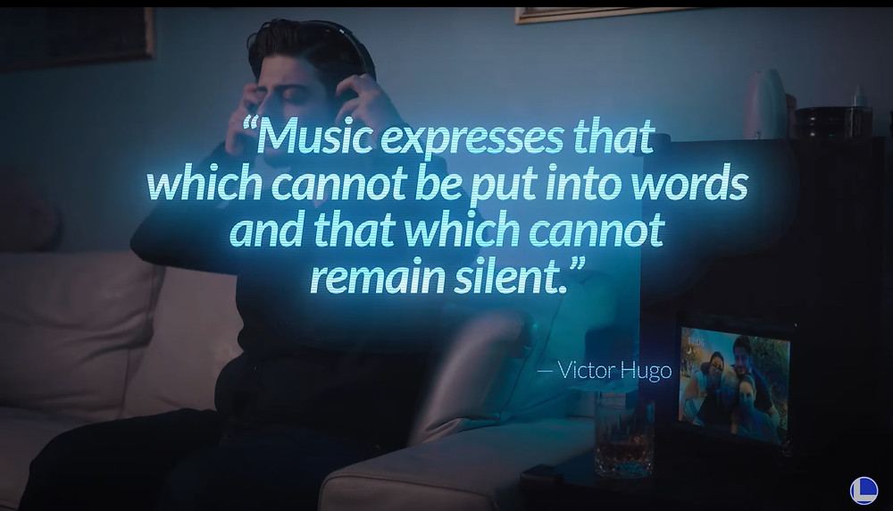 "A man wearing headphones and the quote ""music expresses that which cannot be put into words and that which cannot remain silent"" by Victor Hugo, writer of Les Miserables"