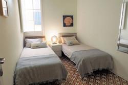Bedroom III 2 single beds, mirrow, ceili