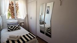Bedroom II: 1 single bed, wardrobe