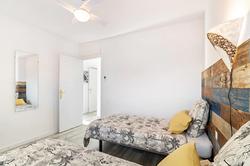 Bedroom II: 2 single beds, commode, ceiling fan